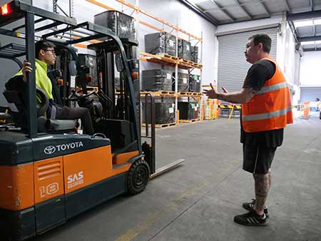Victorian forklift licence student with trainer at Trainix